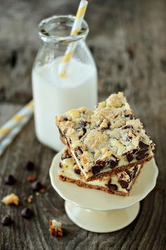 [ Recipe: Cookie Dough Cheesecake Bars ] Using graham cracker crumbs, unsalted butter, light brown sugar, granulated sugar, salt, pure vanilla extract, flour, chocolate chips, cream cheese, and egg. ~ from MyBakingAddiction.com