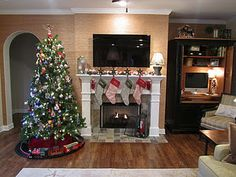 Christmas mantel ideas: garland with lights & left over Christmas balls sitting on top of garland; lanterns filled with balls, pine cones & berries