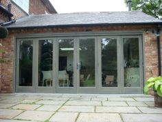 Timber Painted Bi Folding Doors in this garden room Barn Windows, Timber Windows, Windows And Doors, Grey Windows, House Windows, Garden Room Extensions, House Extensions, Kitchen Extensions, House Extension Design