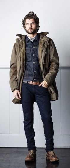 Rugged fall inspiration with a dark wash denim jacket brown leather belt dark wash denim jeans  brown leather boots white collared shirt green winter jacket. model unknown  #jacket #rugged #backpack #denim #denimjacket #boots #selvedge #menswear #mensfashion #menstyle #doubledenim