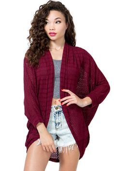 Is it time for school already? An autumn-perfect lightweight cocoon cardigan featuring a crocheted body and an open front. Long dolman sleeves extended hem. Mid-length hem. $18.50