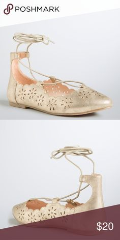 Gold flats Put your flashiest foot forward in these flats. Gold metallic faux leather shines on and bares a bit of sole with floral cutouts. The lace up ankle ties lend a pretty polish to the round toe style. torrid Shoes Flats & Loafers