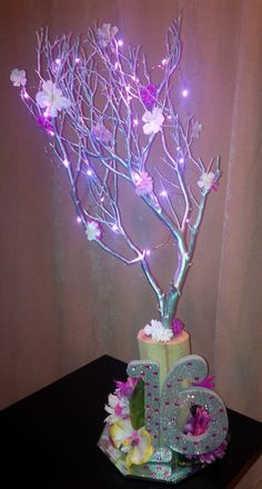 Floral Centerpiece with LED Lights for Sweet Sixteen. For info visit C&C Custom Creations on Facebook.