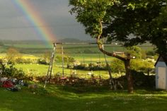 The end of the rainbow lives in our swings at the bottom of our garden :)