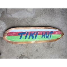 """Rustic hand made surf sign """"TIKI HUT"""" on wood planks. Great piece measuring 40 inches long by 9 inches wide. Perfect for your Tiki Bar."""