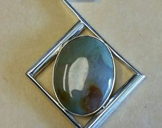 Pale Green Quartz cabachon set in a modern abstract Sterling Silver Pendant with chain.