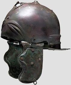 Roman Military Helmet, Weisenan type. Iron with Brss fittings. Madrid Archeological Museum.