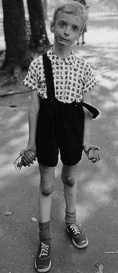 Child with a toy grenade