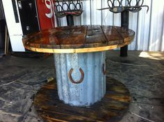 Table I made from a wooden spindle, old barn tin, and a couple of horseshoes - Before After DIY Barn Tin, Old Barn Wood, Salvaged Wood, Into The Woods, Western Decor, Rustic Decor, Western Style, Rustic Furniture, Diy Furniture