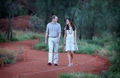 Catherine, Duchess of Cambridge and Prince William, Duke of Cambridge walk around the base of Uluru