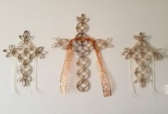 Toilet Paper Roll Art - I made these three crosses using toilet and paper towel rolls.  I have a link under my Arts and Crafts for adults showing how to make the basic cross.  I then added my own flare by making the center one larger and adding ribbon.  I love them!