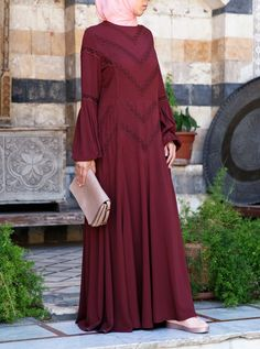 Romantic and breezy, this abaya gown will be your new favorite dress for the season. Crafted to be lightweight and delicate, the feminine vibes are only elevated by the voluminous bell sleeves and dainty lace trim. Keep the accessories simple and neutral for a boho chic look.