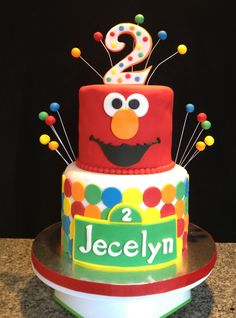 Cute Sesame Street Cake cake with stripes then Elmo and cookie