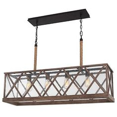 Inspired by French countryside lighting, the Lumiere Linear Suspension by Feiss will add Old World charm to your living space. Pressure-treated oak wood is used to frame seeded glass panes, both of which are complemented by 12-inch rods wound in rope. Ideal for antique Edison bulbs. Dimmable with an incandescent dimmer (not included).