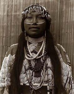 Above we show a majestic photo of a Wishham Indian Girl. It was made in 1910 by Edward S. Curtis.    The illustration documents a Tlakluit woman, half-length portrait, facing front, wearing a heavily beaded buckskin dress, several necklaces, beads, shells, dentalium-shell nose ornament and a headdress of beads and hollow-centered Chinese coins.    We have compiled this collection of artwork mainly to serve as a vital educational resource. Contact curator@old-picture.com.