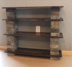 Cheapest and easiest bookshelf ever: Concrete blocks and stained or painted wood..no hammers, nails, etc!