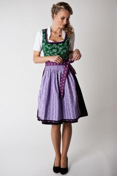Midi Dirndl Anette, green/black/berry  Our exquisite Dirndl Anette is very outstanding with its charming florwal design on the bodice. With the elegant color combination of dark green with a purple apron, the dirndl gets awarded with a certain something.