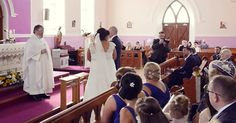 Ceremony halted by voice in back of church– when bride turns around, she bursts into tears