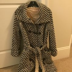 Anthropologie Coat, brand is Sparrow Reduced Price!!!  Women's winter jacket, size Small.  Material is 50% Wool 50% Acrylic; Lining is 100% Cotton.  2 side pockets.  Herringbone pattern with toggle button closure and wrap style belt. Colors are cream, beige and dark Browns and black. Goes with everything!  Worn just a few times, like New condition. Anthropologie Jackets & Coats
