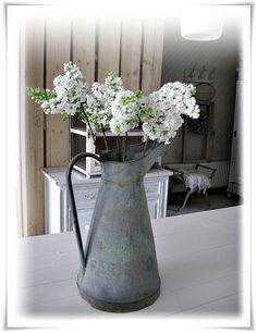 ●White Lilacs in a French Can