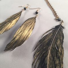 NWOT Gold & Black Feather Necklace and Earring Set Beautiful set. New without tags. Comes with a special free gift!! ⚡️⚡️⚡️FAST SHIPPING BUNDLE DISCOUNTS WILLING TO NEGOTIATE  SMOKE-FREE HOME I ALSO BUNDLE WITH @lv74 CHECK OUT HER CLOSET!  ⚠️⚠️⚠️WANT TO GET RID OF CLOSET FAST--MAKE AN OFFER!! ❤️❤️❤️IM A SUGGESTED USER ON POSH! Jewelry Necklaces