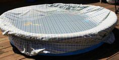 use a fitted sheet to keep kids pool clean when not using