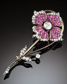 Early 20th century ruby, diamond, flower brooch  Early 20th century ruby and old cut diamond flower brooch with central transition cut diamond in gold and silver topped gold.