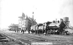 View of Seaboard Airline Engine # 38 At Hamlet, NC. Showing Train Depot and Seaboard Hotel, c. 1912, From real photo postcard by Frank Marchant.