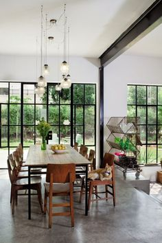 Dining space with big steel framed windows Leaving Room Ideas, Steel Doors And Windows, Dining Table In Kitchen, Dining Rooms, House Front, Cozy House, Decoration, Family Room, Sweet Home