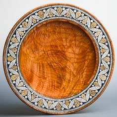 "Tom Wirsing's ""Avoova"". Stunning Big Leaf Maple platter with ostrich eggshell inlay by the Avoova division of Cape Originals, South Africa. Amazing!!! . . #woodturning #woodturneescatalog"