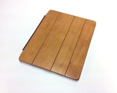 Love a good old fashion wood cover for new technology. This one's an ipad case by DFauberWoodsmith on Etsy.