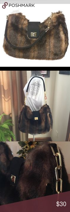 """👜 Vintage Elegant Faux Fur Shoulder Bag Substantial gold Tone hardware with zip top & faux suede flap with twist lock.  Strap is part gold chain & faux suede.  Outside has a vertical zipper (hidden) pocket.  Inside is Linda's signature """"D"""".  1 zip pocket.  I bought this to go with a jacket that had the same faux fur in the hood but is now too small.  Carried a couple times.  Bottom is also fur.  Twist lock has a few small blemishes (scratches) but otherwise great condition. Linda Dano Bags…"""