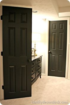 Black interior doors with oil rubbed knobs. love it.