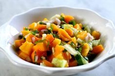 Mango salsa with fresh diced mango, red onion, jalapeno, cucumber, cilantro and lime.  Great with seafood.