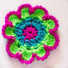 This crochet flower pattern is a great project to help with your color changing skills as it uses three different colors. A Neon Flower like this would look great attached to a bag or hat during the summer season.