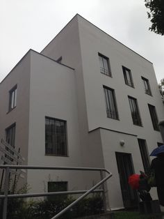 Wittgensteinhaus. Paul Engelmann, a pupil of Adolf Loos, designed this modern home, along with philosopher Ludwig Wittgenstein. The tall, steel doors emphasize the clean, vertical lines of the house.