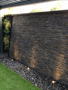 Riven Slate Water Wall, with careful consideration to splash, white water is created running over the surface to give an energetic look with a beautiful sound.