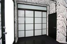 Black finish closet door,quattro design and milky glass #the_sliding_door_company The Sliding Door Company