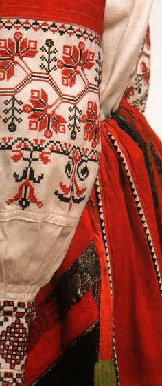 Embroidery on the sleeves presents the art of Russian and Ukrainian women in medieval times.