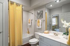 Trendy and Refreshing: Gray and Yellow Bathrooms That Delight Curtain with chevron stripes brings yellow to the modern gray bathroom [Photo Credit: Valerie Ryan Photography / RealPage, Inc] ideas grey Yellow Bathroom Decor, Yellow Bathrooms, Bathroom Colors, Bathroom Interior, Modern Bathroom, Bathroom Grey, Vanity Bathroom, Bathroom Cabinets, Bathroom Wall