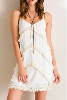 Dusty Diamonds Boutique - Ivory Shift Dress (with Lining) and Fringe Detail, $46.95 (http://dustydiamondsboutique.com/ivory-shift-dress-with-lining-and-fringe-detail/)