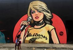 This work is a mural of Debbie Harry and was created for the space 52 mural project for the Miami Art Basel in 2015. This work ha sheen painted on the side of a building which make its impressive. another reasons is the colours used, dark backgrounds with a bright character.