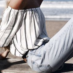 white and blue striped off the shoulder top and high waisted faded jeans. casual summer outfit.