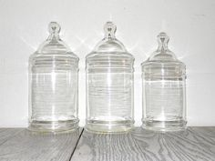 Vintage apothecary jars... I need to find one or two big applicant jars for the guests to put their memory rocks in!