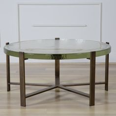 KELLY WEARSTLER | PICKFAIR COFFEE TABLE. Solid burnished bronze base with a glass top