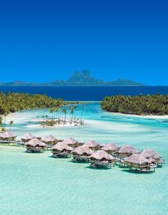 Islands of Tahiti../// I can just imagine myself in one of those huts right now!