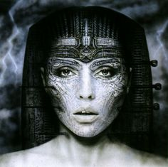 This is a more toned down version of Gigers work. The album cover features more subtle use of mechanical imigary such as computer chips and plugs in the headress. I want to avoid this if I can as she looks to organic herself and the headress too mechanical I want everything to be blended together The instruments inserted into her face shows his dark imaginary more and shows spoilt beauty. I could use similar themes in my work.