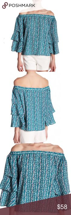 NWT ROMEO & JULIET COUTURE TOP SIZE SMALL NWT Romeo and Juliet Couture printed top  Off shoulder. Ruffled bell sleeves.  Size small  Pit to pit approximately 19 inches  Length approximately 18 inches 100% polyester Romeo & Juliet Couture Tops Blouses
