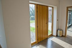 Je-Trae Plank Entrance door with matching side lights. http://www.olsenuk.com/products/entrance-doors/je-trae-traditional