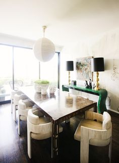 Green console table in dining room with modern furniture